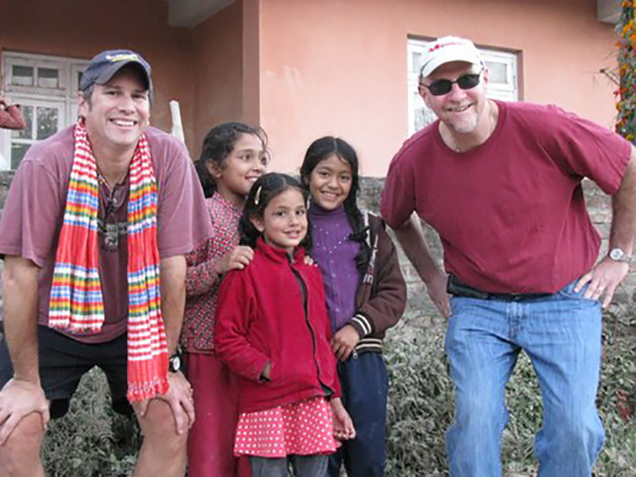 Bob Carlsen (left) and Mike Cammarota with children in Nepal