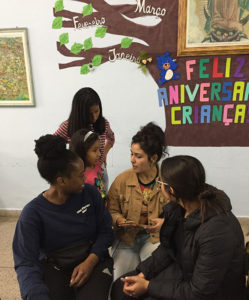 """Margarita talks with children in front of the """"birthday tree"""" at the Center for Immigrant Integration."""